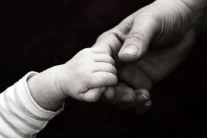 holding baby hand 105089895 300x200 In Memory of the Perfect Imperfect Pregnancies